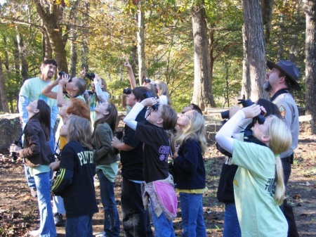 A Park Interpreter leads a group through the wonders of the park