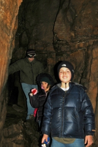 Spencer Foster, Laurel Chafin, and Jay Chafin delight in finding tri-colored bats (Perimyotis subflavus) hibernating in Devil's Den Cave