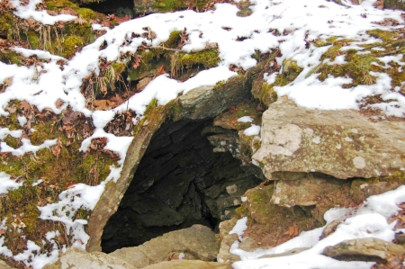 Snow covers the entrance to one of the many sandstone, fracture caves at Devil's Den State Park