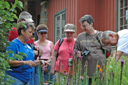 Volunteer Beverly Duke leads a garden tour at the Visitor Center.