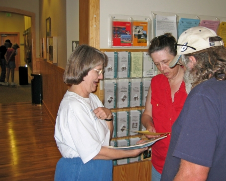 Volunteer Carolyn Allen greets and orients visitors.