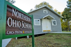 The restored 1910 Northern Ohio School House interprets the life of timber workers children.