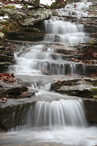"""Longer exposure times will help you """"silk"""" the water as it falls."""