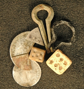 Artifacts like these jaw harps and dice, unearthed at  Davidsonville, show the townspeople lived lives that included leisure  time.