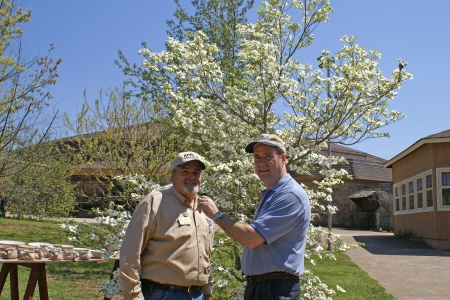 Ozark Folk Center's Group Sales Manager Jimmie Edwards shares comments with KFFB's General Manager Bob Connell.