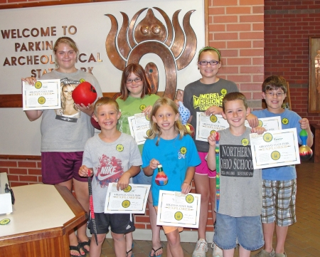 A group of kids receive their Explorer Certificates at Parkin Archeological State Park.